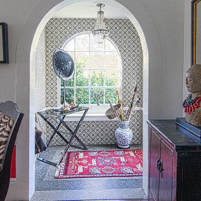 Eclectic entryway photo in San Francisco with white walls