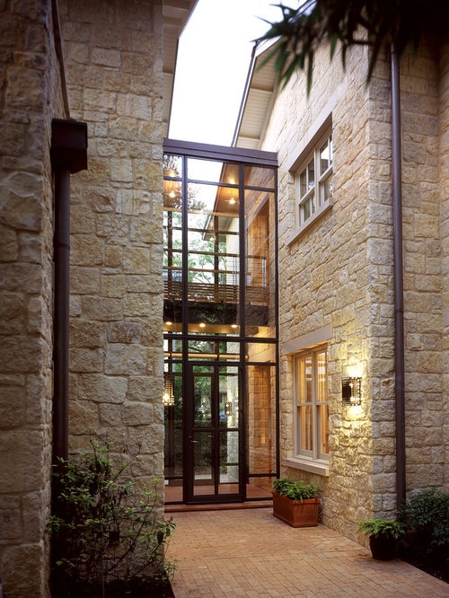 Two story glass home design ideas pictures remodel and decor for Entrance from garage to house