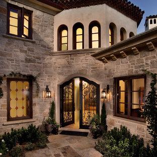 Design ideas for a mediterranean front door in San Diego with a double front door and a metal front door.