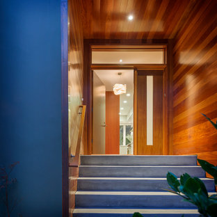 Photo of a contemporary front door in San Francisco with a single front door and a medium wood front door.