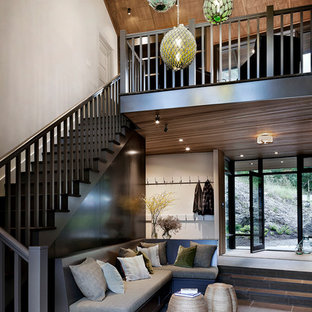 Example of a large mountain style slate floor and black floor foyer design in Seattle