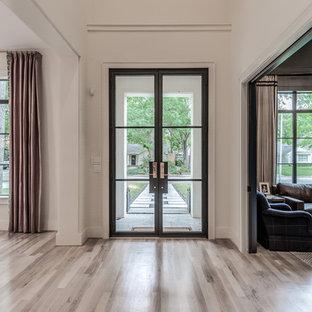На фото: класса люкс огромные прихожие в стиле современная классика с белыми стенами, светлым паркетным полом, двустворчатой входной дверью, металлической входной дверью и бежевым полом