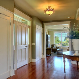 Design ideas for a traditional entry hall in Seattle with green walls and medium hardwood floors.