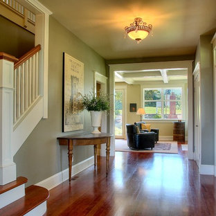 Example of a classic entryway design in Seattle with green walls