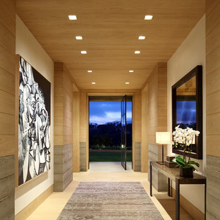 Inspiration for a contemporary light wood floor entryway remodel in Los Angeles with multicolored walls and a glass front door