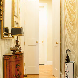 Entryway - eclectic medium tone wood floor entryway idea in New York with multicolored walls and a white front door