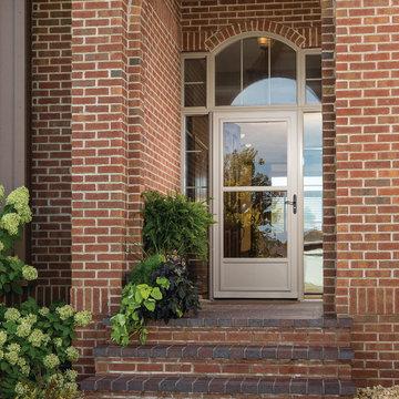 Screen Away® Almond Door on Brick Home