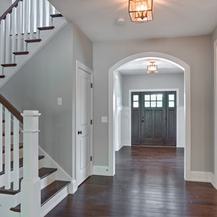 Inspiration for a mid-sized craftsman dark wood floor entryway remodel in Other with gray walls and a dark wood front door