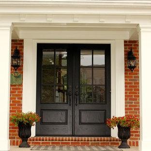 Idéer för en mellanstor klassisk ingång och ytterdörr, med betonggolv, en dubbeldörr och en svart dörr