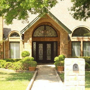 Example of a large entryway design in Dallas with a metal front door