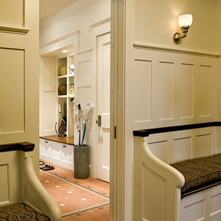 Inspiration for a victorian mudroom remodel in Burlington with beige walls