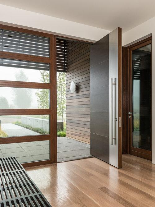 Inspiration For A Contemporary Medium Tone Wood Floor Pivot Front Door  Remodel In Salt Lake City