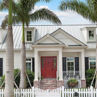 Entryway - mid-sized traditional entryway idea in Tampa with white walls and a red front door