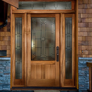 Example of an arts and crafts entryway design in Sacramento with a medium wood front door