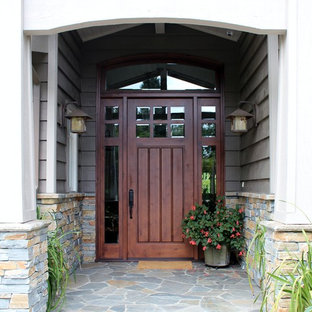 Example of a large transitional slate floor front door design in San Francisco with gray walls and a brown front door