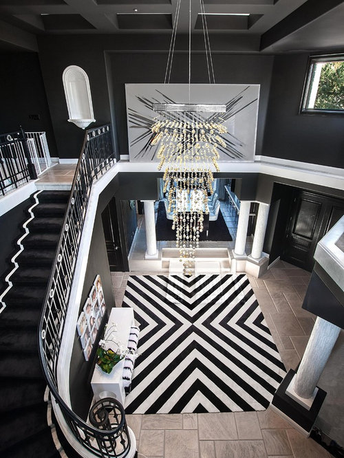 Contemporary Foyer Idea In Orange County With Black Walls And Gray Floors Save Photo Coast Interior Design