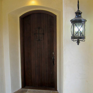 Small Spanish Style Cottage Front Door with Speakeasy and iron grille