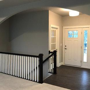 Front door - mid-sized modern vinyl floor and brown floor front door idea in Other with gray walls and a white front door