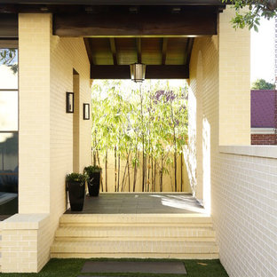 Inspiration for a contemporary front door remodel in Tampa with beige walls