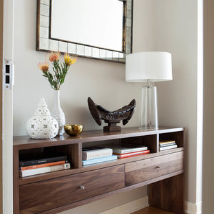 Inspiration for a small contemporary light wood floor entryway remodel in San Francisco with beige walls and a white front door