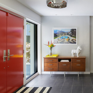Photo of a large midcentury foyer in DC Metro with a double front door, grey walls, slate flooring, a red front door and grey floors.