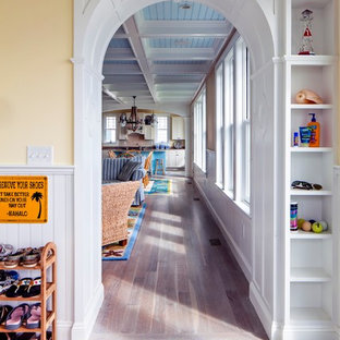 Inspiration for a mid-sized beach style entry hall remodel in Portland Maine with yellow walls