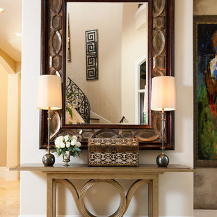 Inspiration for a mediterranean entryway remodel in Houston with beige walls