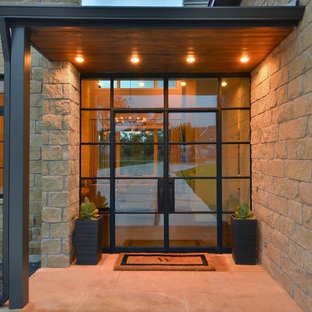 Trendy entryway photo in Austin with a glass front door