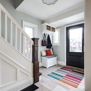 Inspiration For A Small Transitional Marble Floor Entryway Remodel With Gray Walls And Black Front