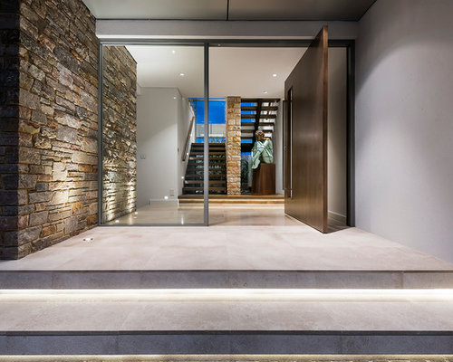 staircase lighting ideas. Photo Of A Mid-sized Contemporary Front Door In Perth With Concrete Floors, Staircase Lighting Ideas