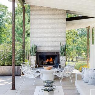 Inspiration pour une entrée design avec béton au sol, un sol gris et un plafond voûté.