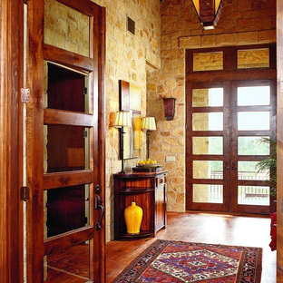 Entryway - eclectic entryway idea in Austin with a glass front door