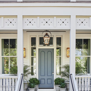 Design ideas for a beach style front door in Jacksonville with a single front door and a grey front door.