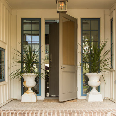 Inspiration for a coastal entryway remodel in Charlotte with a gray front door