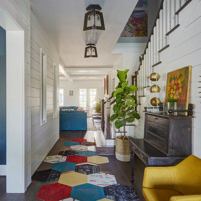 Country dark wood floor and brown floor entry hall photo in Houston with white walls