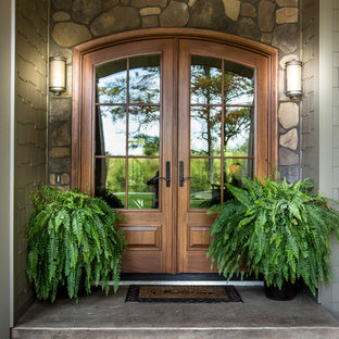 Mid-sized arts and crafts entryway photo in Other with a medium wood front door