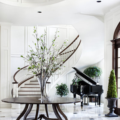 Inspiration for a huge timeless marble floor foyer remodel in Austin with white walls