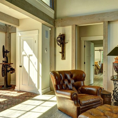 Large farmhouse brick floor entryway photo in Burlington with beige walls and a white front door