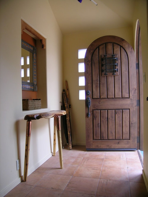 Ex&le of a small southwest terra-cotta floor entryway design in San Francisco with a & Speakeasy Door | Houzz Pezcame.Com