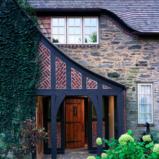 Inspiration for a timeless single front door remodel in Philadelphia with a dark wood front door