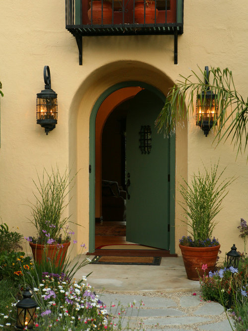 Spanish colonial revival houzz for Mediterranean style entry doors