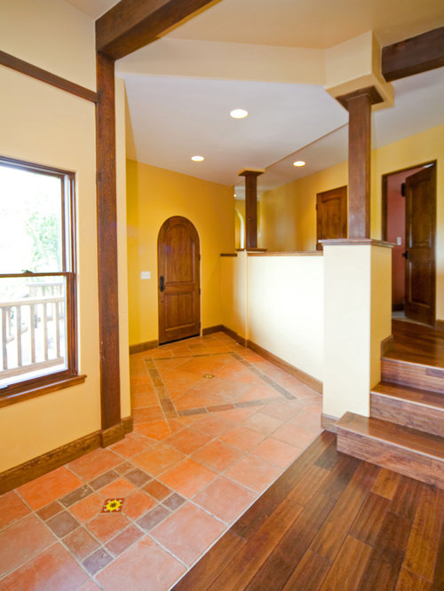 Southwestern Entryway Design Ideas Remodels Photos With Yellow Walls
