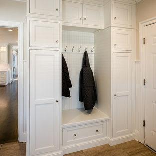 Photo of a mid-sized arts and crafts mudroom in Philadelphia with beige walls, a single front door and a white front door.