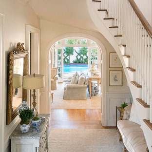 Inspiration for a mid-sized eclectic foyer in Dallas with a single front door, a white front door, white walls, medium hardwood floors and brown floor.