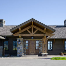 Rustic Entry by Teton Heritage Builders