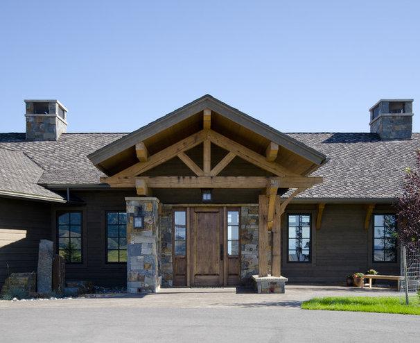 Rustic Entry by Teton Heritage Builders