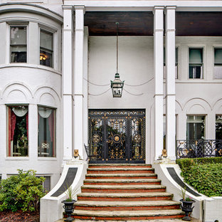 Inspiration for a victorian single front door remodel in Other with white walls and a glass front door