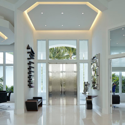 Trendy porcelain tile entryway photo in Miami with white walls and a metal front door