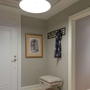 Entryway - small contemporary medium tone wood floor entryway idea in New York with gray walls and a white front door