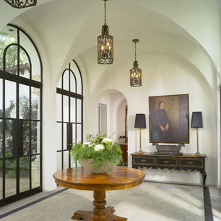 Inspiration for a mediterranean entryway remodel in Atlanta with white walls and a glass fron
